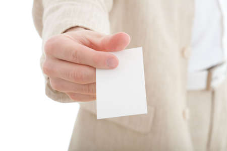 Hand holding a business card with copy space over white background. photo