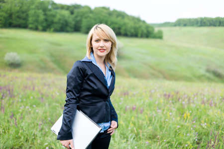 Businesswoman with laptop stay on meadow Stock Photo - 3071660