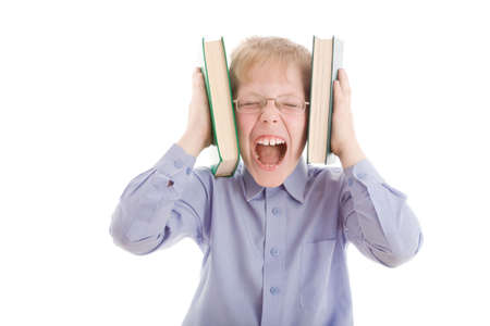 bawl: Boy squeeze head by two books and scream. Isolated on white background.Conceptual image about modern overflow of information.