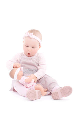 ittle: Sweet ittle girl play with doll. Over white background