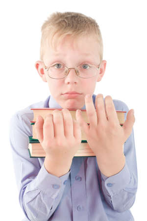 puzzlement: Portrait of confused boy holding three books. Boy slightly puzzlement. Isolated on white background