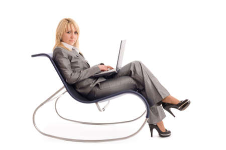 Businesswoman with laptop rest in chair over white background Stock Photo - 3179192