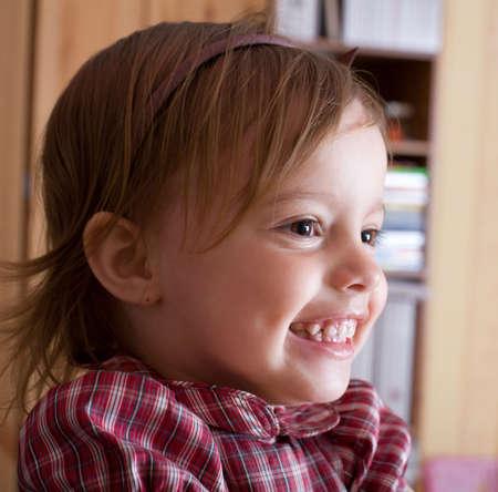 hilarity: Portrait of a joyful little girl in living room