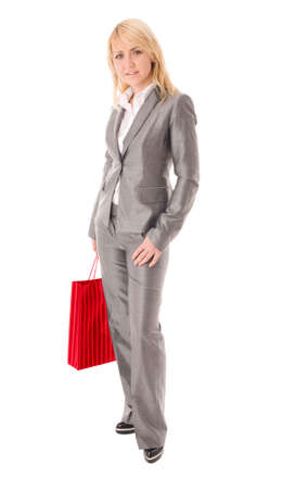 Portrait of happy businesswoman with red shopping bag photo