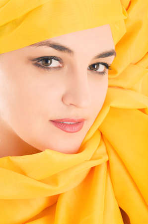 Woman covering with yellow chiffon cloth photo