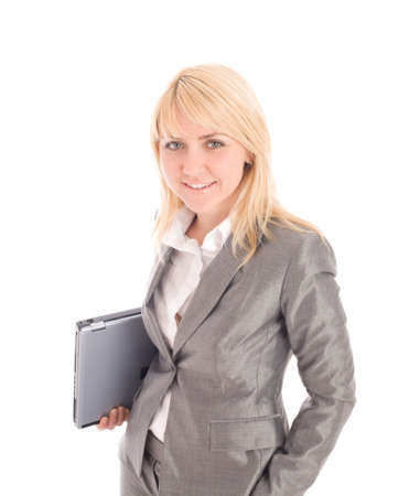 Smiling  businesswoman holding laptop under ones arm. Isolated on white background photo