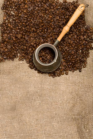 cezve: Cezve with freshly roasted coffee beans on sackcloth