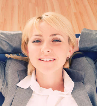 Businesswoman relaxing and feeling on top of things photo