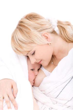 seni: Madre al seno il suo bambino ragazza in camera bianca a casa Archivio Fotografico