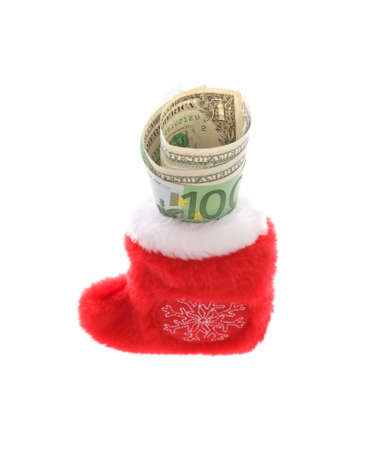 Red christmas sock with euro covering dollars cash money isolated on white photo