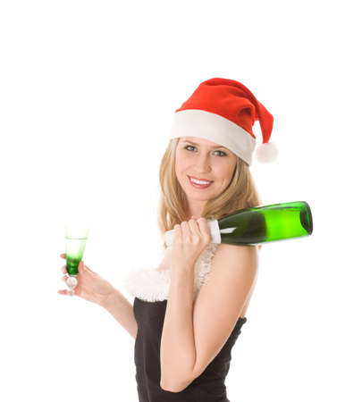 Smiling blond girl in red santa hat holding glass and bottle of wine isolated on white photo
