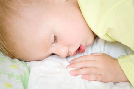 soporific: Restful two years baby boy sleeping on bed Stock Photo