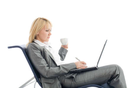 Businesswoman with laptop and cup of coffee rest in chair isolated on white.Concept about fresh solutions and ideas n business. photo
