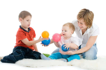 nanny: Mother with her sons enjoy with colorful balls over white background