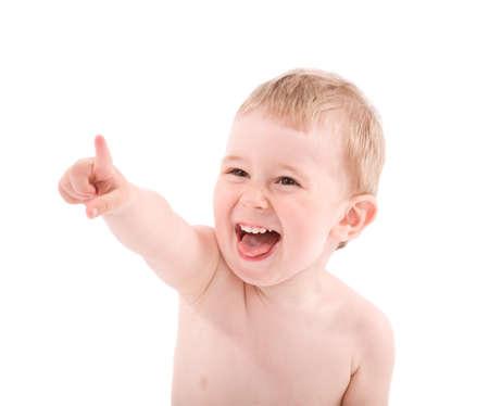 何かに指で指している赤ちゃんの肖像画。白い背景で隔離されました。