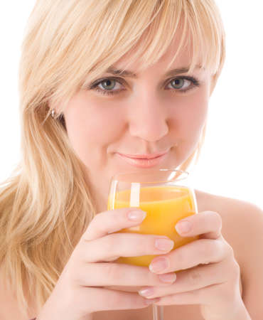 Attractive girl drinking fresh orange juice and smile photo