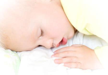 slumberous: Restful two years baby boy sleeping on bed Stock Photo