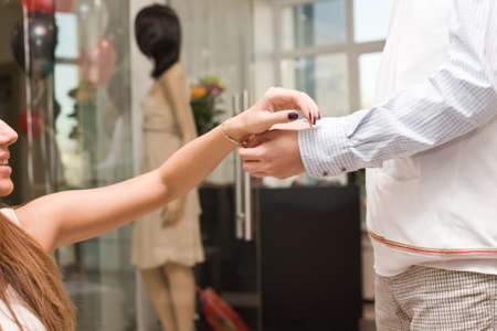 Man give gold bracelet to happy woman in the jewellers store Stock Photo