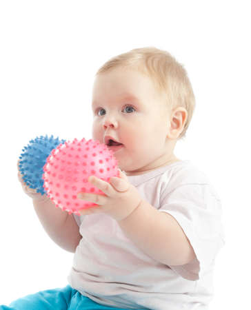 Portrait of little boy with two massage balls over white Stock Photo