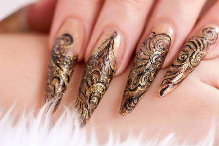 Human hand with the beautiful fingernail manicure Фото со стока