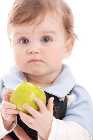 Portrait of adorable blue-eyes baby hold green apple. Over white Stock Photo - 4812706