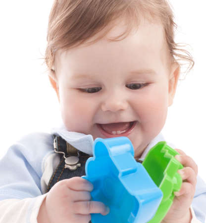 Portrait of adorable happy blue-eyes baby boy playing with toys. Face close-up Stock Photo - 4820992