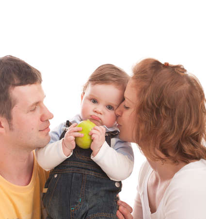 Young happy family: mother, father and baby with green apple. Isolated on white photo