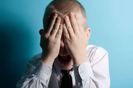 Screaming scared teenager close your face by hands Stock Photo - 4907561