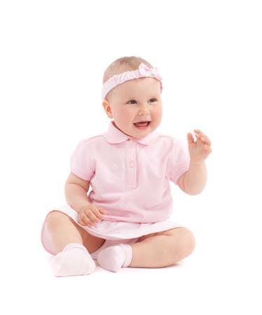 children socks: Sweet happy little girl sit over white background Stock Photo