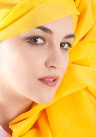 Woman covering in yellow chiffon cloth photo