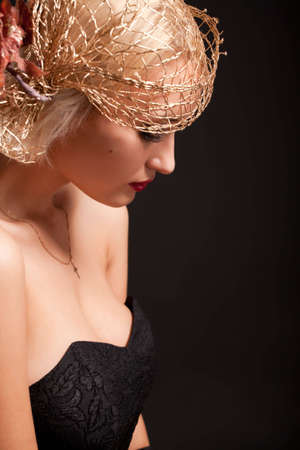 Portrait of attractive retro-style woman in bonnet over black photo