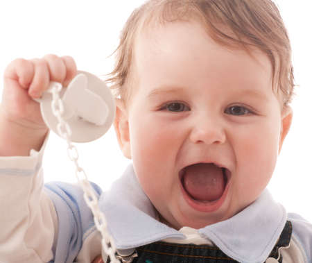 Portrait of joyful baby boy with pacifier over white photo