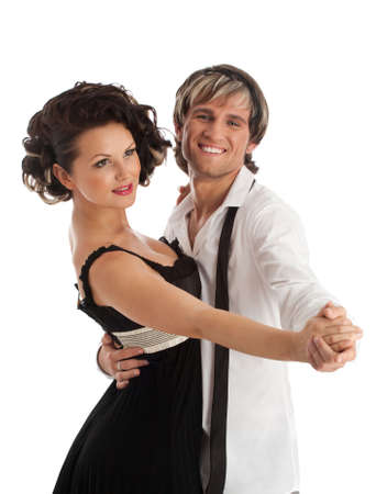 Happy smiling dancing couple. Isolated over white