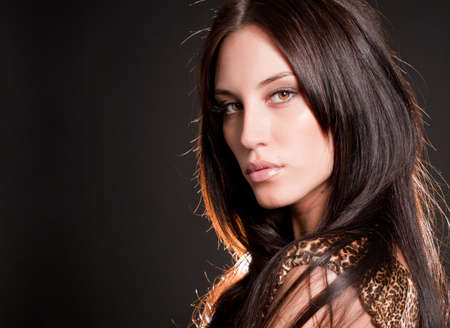 Portrait of attractive brunette sexy girl over gray Stok Fotoğraf