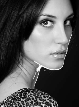 BW portrait of attractive brunette sexy girl over black photo