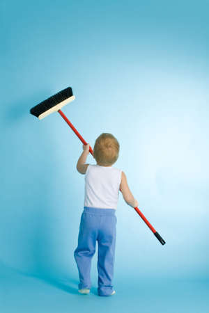 scavenging: Little boy with cleaning swab over blue background