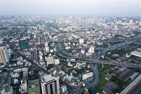 View from the Bayoke Sky Hotel on Bangkok. Buildings in Bangkok highlighting the pollution problem showing the smog on a relatively clear day.  photo