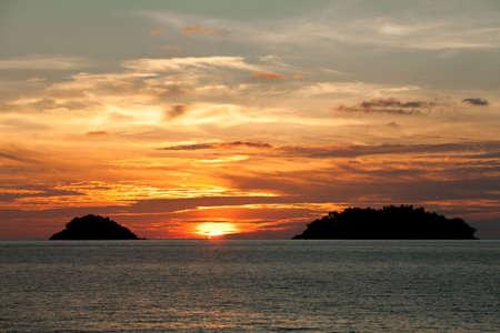 Sun go down between two islands. View from Kai Bae beach. Koh Chang Island. Thailand photo