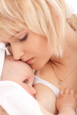 Mother breast feeding her newborn baby girl Stock Photo