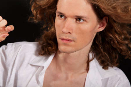 Portrait of long-haired handsome man with flying hair