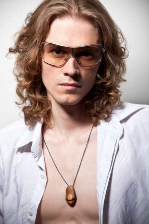 Portrait of long-haired handsome man in sunglasses photo