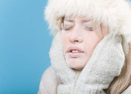 chilled: Frozen. Close-up portrait of chilled female face covered in snow ice. Stock Photo