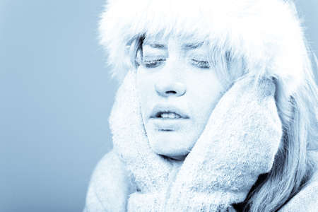 freeze: Frozen. Close-up portrait of chilled female face covered in ice. Stock Photo