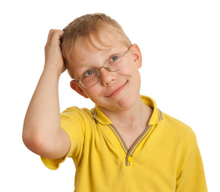 puzzlement: Boy scratches his head in puzzlement or confusion, as if pondering a deep question. Over white background.
