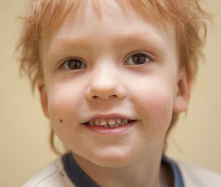 Portrait of smiling happy boy photo