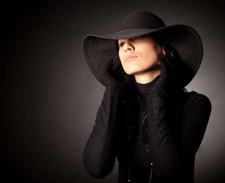 Attractive brunette girl in the wide-brimmed hat photo