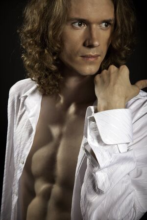 Portrait of long-haired handsome man with naked torso Stock Photo
