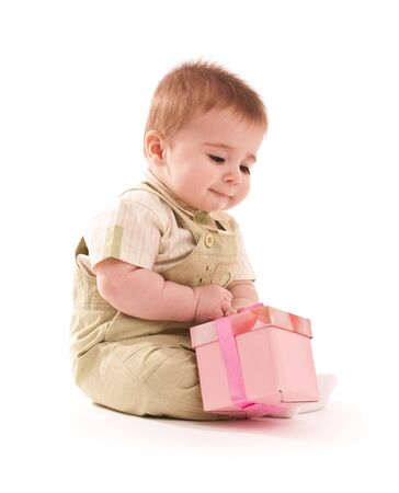 Portrait of happy baby boy with small pink gift box photo