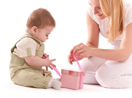 Mother present to her baby boy gift in pink box Stock Photo - 9662499