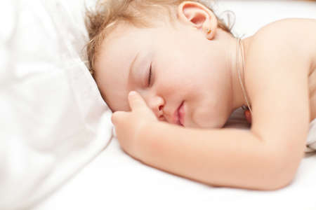 slumberous: Restful two years baby girl sleeping on bed